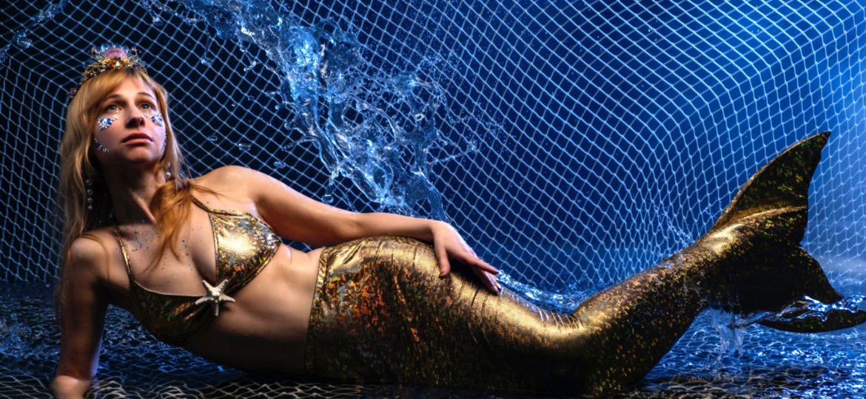 playing dress up as mermaid
