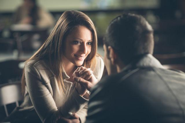 Romantic couple flirting at the bar_small