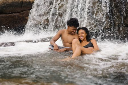 Happy couple by a waterfall